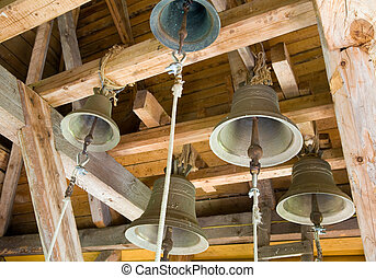 Church bells under the roof of christian monastery