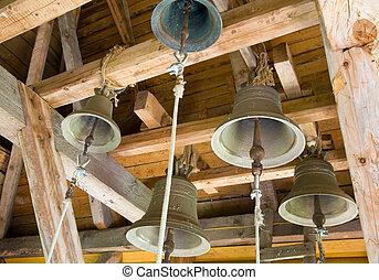 church bells - Church bells under the roof of christian...