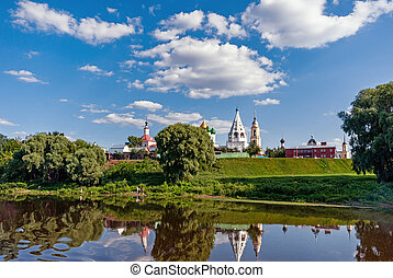 Church buildings in a Sunny cloudy day on the banks of the Moscow river City Kolomna Moscow region