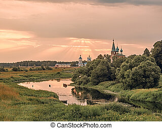 church by the river. summer landscape in the  village