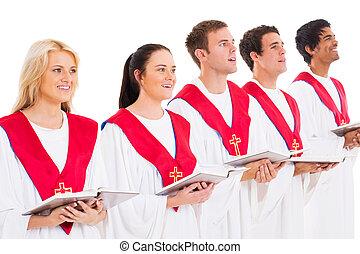 church choir members holding hymn books and singing