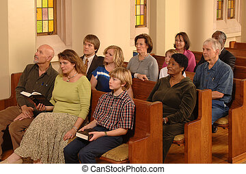 Congregation sitting in pews in a church listening to a sermon