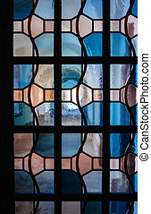 Church corridor through stained glass