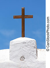 Church cross - Christian cross of wood on a white church...