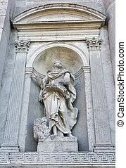 Church del Santissimo Redentore facade wall statue in Venice, Italy.
