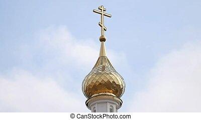 Church dome with a cross against a blue sky - Church dome...