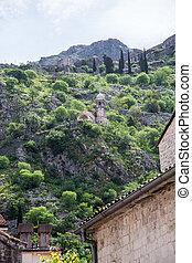 Church Domes Beneath Hills Over Kotor