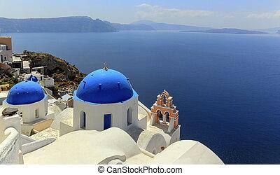 Church domes in Oia, Santorini, Greece