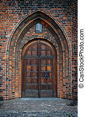Church Door - An arched doorway to a gothic style church.