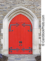 Church Doors - Red church doors on a old stone church
