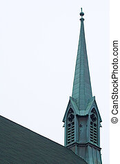 Exterior shot of a church roof and steeple.