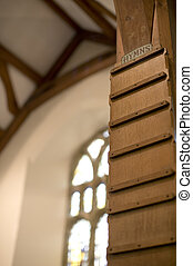 blank wooden hymn board in a gothic style church