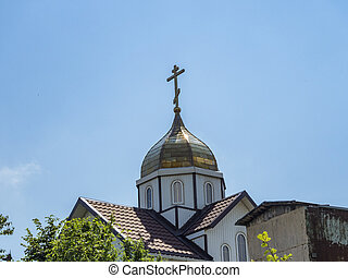 Church in the forest dome with a cross