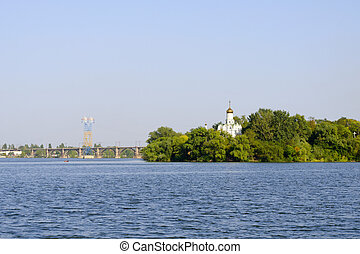 Church in the trees on the bank of the river