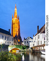 Church of Our Lady and bridge over water canal by night,...