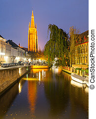 Church of Our Lady and water canal by night, Bruges,...