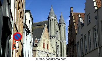 Church of Our Lady Bruges and traditional houses in Bruges, Belgium.