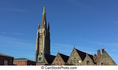 Impressive Church of Our Lady Bruges and traditional houses in Bruges, Belgium.