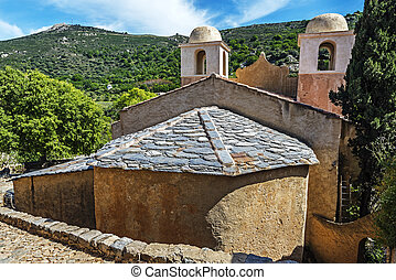 Church of Pigna village in Corsica Island seen from village ...