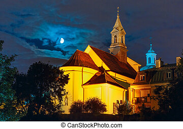 Church of Saint Benson in New Town of Warsaw at moonlit night, Warsaw Old town, Poland.