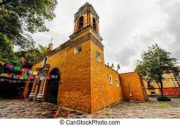 Church of Santa Catarina (Iglesia de Santa Catarina). A 16th century, bright yellow, baroque church in the Coyoacan district of Mexico City.