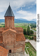 Church of the Archangels and Caucasus mountains in Kakheti