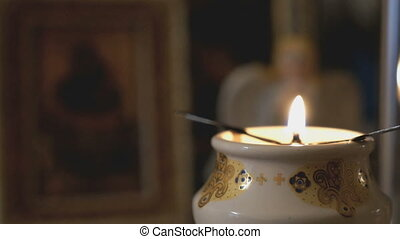 Church oil lamp with a burning candle in Church - Church oil...