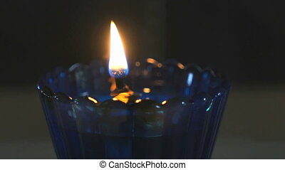Church oil lamp with a burning candle in temple