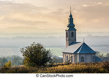 church on a hill at sunset - church on a hill over the hazy...