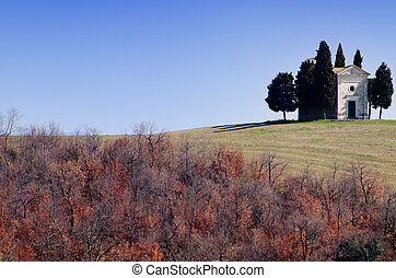Church on a hill with cypress trees