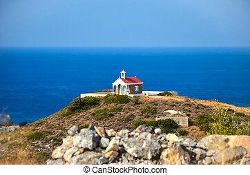 Church on a hilltop overlooking the blue sea
