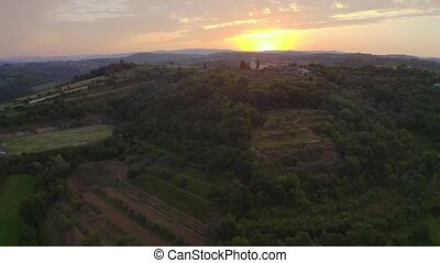 Church on hill - Sunrise aerial view on church on hill and ...