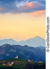 Church on the hill at sunset at Sveti Tomaž, Slovenia -...