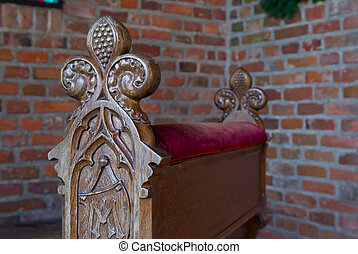 church pew - small wooden pew in a chapel