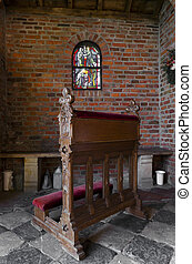 small wooden pew in a chapel