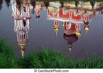 church reflection in river water