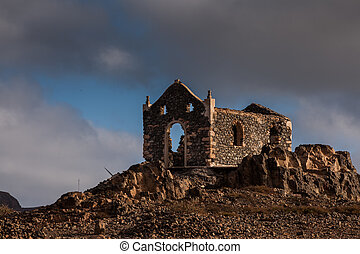church ruin - forlorn ruin of a church standing on a hill