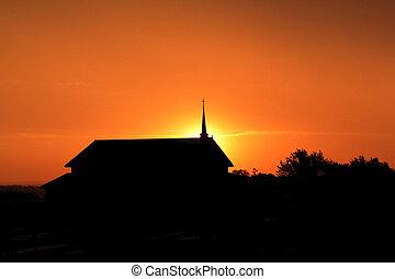 Church steeple at sunrise