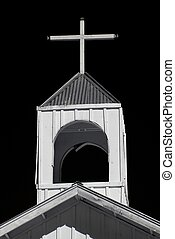 Black and white old church steeple cross