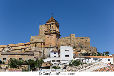 Church tower and castle on the hilltop of Alcaudete