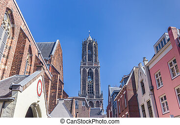 Church tower and colorful houses in Utrecht