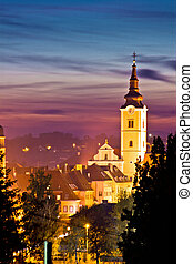 Church tower in colorful dusk, Town of Krizevci, Croatia
