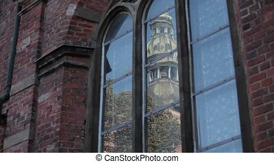 Church tower in the reflection of glass sign, design,...