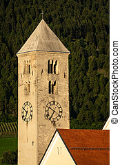 Church tower of St. Johannes in Laas on a sunny morning in summer