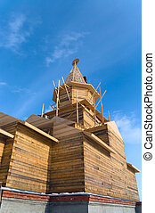 Church under construction on the blue sky background