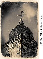 Church wind vane - A golden wind vane above a church in the...