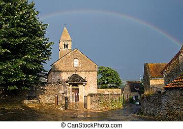 Church with a rainbow of Taize ,Burgundy. - Church with a...