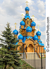 Church with blue domes in Moscow district