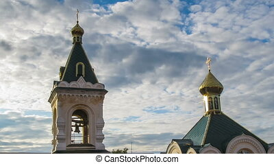 Church with Gold Domes Against the Sky and Moving Clouds -...