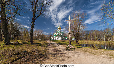 Church with golden cupola and wooden cross
